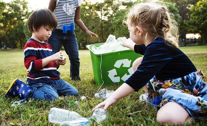 Kids Collecting And Recycling Waste